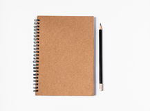 Notebook. And pencil on white background Royalty Free Stock Photo