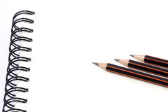 Notebook and pencil on white background Stock Photography