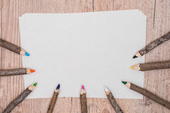 Notebook and pencil on wood background stock images