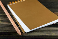 Notebook with pencil on wood Stock Images