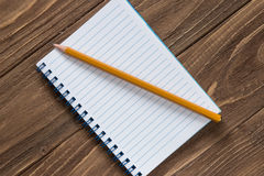 Notebook with pencil on wooden background. Close-up Stock Photo