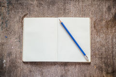 Notebook with pencil Stock Images