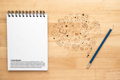 Notebook with pencil on wooden table Stock Photography