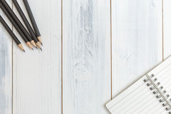 Notebook and pencil on wooden table, Top view, Concept of workplace, office supplies, background Stock Photo