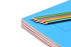 Notebook and pencils Stock Images