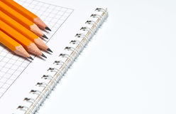 Notebook and pencils. On white Royalty Free Stock Images