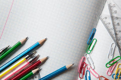 Notebook with pencils and color clips Stock Photos