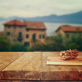 Notebook and pencils on old wooden table in front of romantic Provence rural landscape. retro filtered image Stock Images