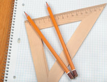 Notebook with pencils and triangle Stock Photos