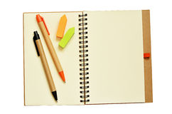 Notebook, pens, and stickers. Isolated on white royalty free stock images