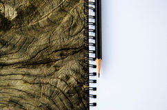 Notebook with pensil on old tree Royalty Free Stock Photography