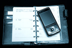 Notebook and phone. Notebook, calendar and phone in black background royalty free stock images