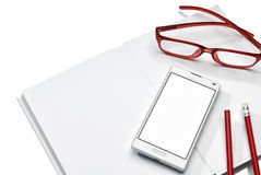 Notebook, phone and glasses Stock Photography