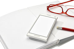 Notebook, phone and glasses Royalty Free Stock Photos