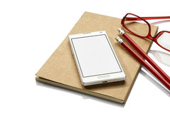 Notebook, phone and glasses Royalty Free Stock Image