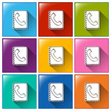 Notebook with phone icons Royalty Free Stock Images