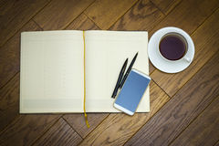 Notebook phone pen cup Stock Images
