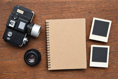 Notebook with photo frames and camera Stock Photo