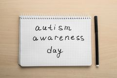 Notebook with phrase. `Autism awareness day` on light background Stock Photo