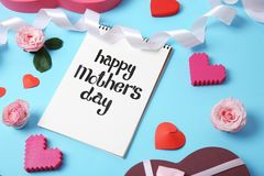 Notebook with phrase. `HAPPY MOTHER`S DAY` and decor on color background Stock Photo