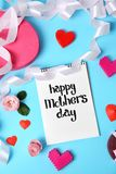 Notebook with phrase. `HAPPY MOTHER`S DAY` and decor on color background Royalty Free Stock Photos