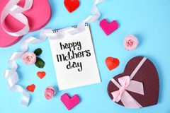 Notebook with phrase. `HAPPY MOTHER`S DAY`, decor and gift box on color background Royalty Free Stock Photo