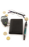 Notebook with pin calculator and eyeglasses Stock Photography