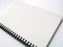 Notebook - plain. White notepad isolated with white background Stock Photography