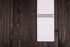 Notebook. A notebook on the planks Royalty Free Stock Photo