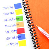 Notebook post it monday to sunday Royalty Free Stock Image