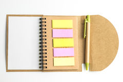 Notebook and postit and pen. Royalty Free Stock Images