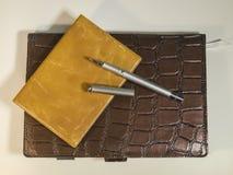 Notebook, purse and beautiful metal ballpoint pen Royalty Free Stock Photos