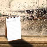 Notebook with  rainy day window Royalty Free Stock Image