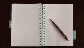 Notebook ready to write. Stationery notepad and pencil Stock Photo