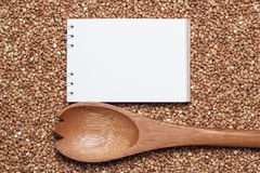 Notebook for recipe over buckwheat background Royalty Free Stock Image