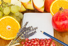 Notebook for recipes. Blank notebook for recipes with frame of fruits Royalty Free Stock Images