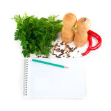 Notebook with recipes. And shopping list in the kitchen Stock Image