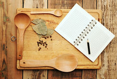 Notebook for recipes. And spices on wooden table Stock Photo