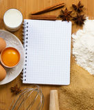 Notebook for recipes with baking ingredients Royalty Free Stock Photos