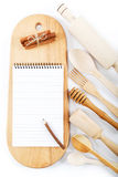 Notebook for recipes, cooking utensils. Royalty Free Stock Photos