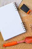 Notebook for recipes. A empry notebook for recipes  on wood desk Royalty Free Stock Photo