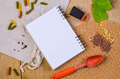 Notebook for recipes. Empty notebook for recipes  on wood desk Royalty Free Stock Images