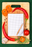Notebook with recipes and in the kitchen Stock Photography