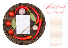 Notebook with recipes list. Notebook with recipes and shopping list, on a barrel Stock Photos