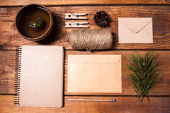 Notebook for recipes, paper envelopess, rope and. Clothespins on wooden table. concept of eco-friendly items Royalty Free Stock Photography