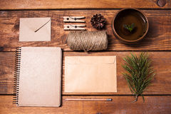 Notebook for recipes, paper envelopess, rope and. Clothespins on wooden table. concept of eco-friendly items Stock Images