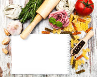 Notebook for recipes. Pasta  and spices on wooden table Stock Images