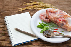 Notebook for recipes and raw  chicken bone Royalty Free Stock Photography