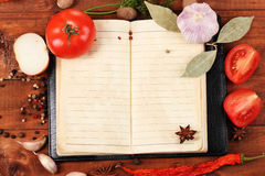 Notebook for recipes and spices. On wooden table Royalty Free Stock Photos
