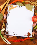 Notebook for recipes and spices. On wooden table Stock Photography